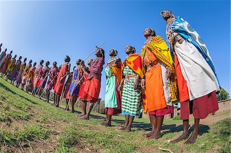 Africa, Kenya, Narok County, Masai Mara. Masai men and women dancing at their homestead. Stock Photo - Rights-Managed, Code: 862-08090823