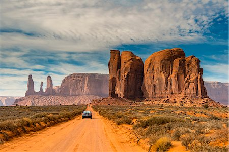 Unpaved road with scenic desert landscape, Monument Valley Navajo Tribal Park, Arizona, USA Stock Photo - Rights-Managed, Code: 862-08091459