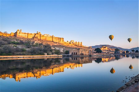 India, Rajasthan, Jaipur, Amer.  The magnificent 16th century Amber Fort at sunrise with two hot air balloons aloft. Stock Photo - Rights-Managed, Code: 862-08273278