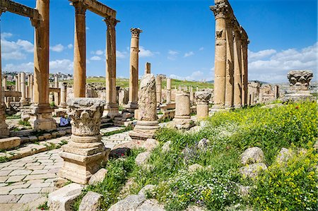 Jordan, Jerash.  A section of the  Cardo  of the ancient Roman city of Jerash. This 600 metres long colonnaded street dates to about 120 AD and runs the length of the city. It was once lined with shops and residences. Stock Photo - Rights-Managed, Code: 862-08273500