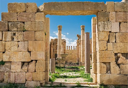 Jordan, Jerash.  The 6th century ruins of the Byzantine Church of the Propylaea viewed through the  Cardo  to the Propylaeum   the gateway leading to the Temple of Artemis in the ancient Roman city of Jerash. Stock Photo - Rights-Managed, Code: 862-08273501