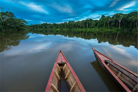 South America, Peru, Amazonia, Manu National Park, UNESCO World Heritage, dugout boat on old oxbow lake Stock Photo - Rights-Managed, Code: 862-08273778