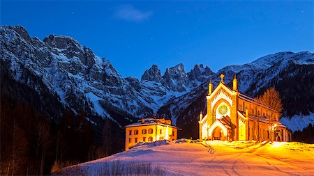 Europe, Italy, Veneto. The parish church of Falcade in the late evening with behind the towers of Focobon.  Agordino, Dolomites Stock Photo - Rights-Managed, Code: 862-08698832