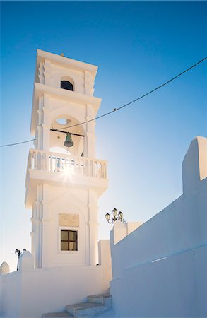 Greece, Santorini, Imerovigli. Afternoon sun shining through a church bell tower. Stock Photo - Rights-Managed, Code: 862-08699270