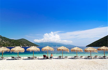 Greece, Kefalonia, Sami. Parsols and sunbeds on Antisamos beach near Sami. Stock Photo - Rights-Managed, Code: 862-08699289