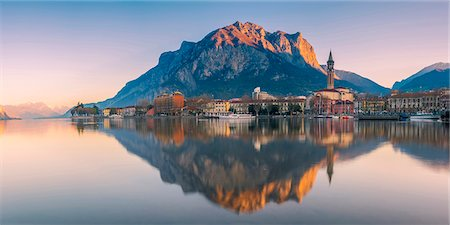 Lecco, lake Como, Lombardy, Italy. Panoramic view of the city at sunrise with the St. Martin mount reflected in the lake's waters Stock Photo - Rights-Managed, Code: 862-08699433