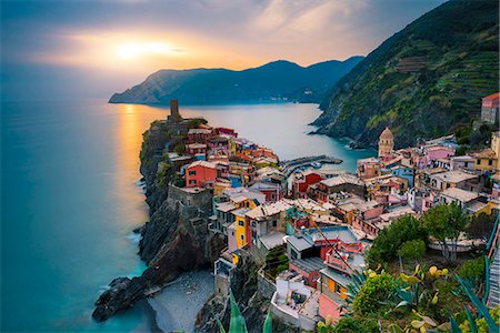 Vernazza, Cinque Terre, La Spezia, Liguria, Italy. The town and the castle at sunset. Stock Photo - Rights-Managed, Code: 862-08699464