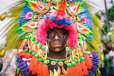 pictures philippine festivals philippines - A participant of Ati-atihan festival wears a brightly colored costume, Kalibo, Aklan, Western Visayas, Philippines Stock Photo - Rights-Managed, Code: 862-08699700