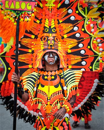 pictures philippine festivals philippines - A participant of Ati-atihan festival wears a brightly colored costume, Kalibo, Aklan, Western Visayas, Philippines Stock Photo - Rights-Managed, Code: 862-08699701