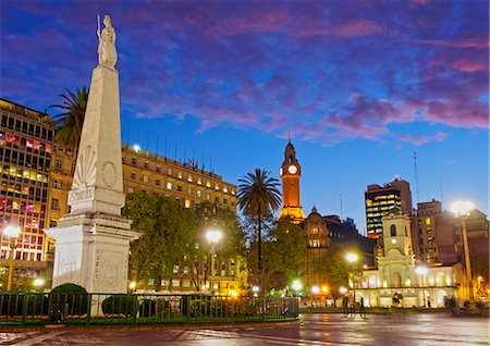 Argentina, Buenos Aires Province, City of Buenos Aires, Monserrat, Twilight view of Piramide de Mayo and Cabildo on Plaza de Mayo. Stock Photo - Rights-Managed, Code: 862-08718424