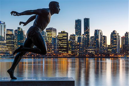 Statue of Harry Jerome with downtown skyline in the background, Stanley Park, Vancouver, British Columbia, Canada Stock Photo - Rights-Managed, Code: 862-08718513