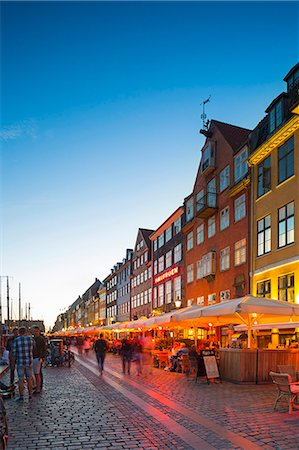 Denmark, Hillerod, Copenhagen. Restaurants and bars along the 17th century Nyhavn waterfront. Stock Photo - Rights-Managed, Code: 862-08718559