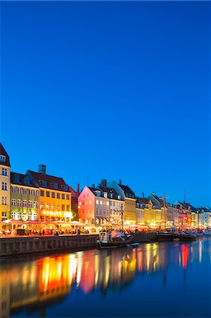 european bar building - Denmark, Hillerod, Copenhagen. Colourful buildings along the 17th century waterfront of Nyhavn at dusk. Stock Photo - Rights-Managed, Code: 862-08718564