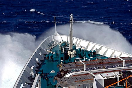 sailing boat storm - Antarctica,Antarctic Peninsula,Drakes Passage. Running into heavy seas,the bow of the expedition ship MV Discovery cut a path through the deep blue sea separating the southern continent from South America. Stock Photo - Rights-Managed, Code: 862-03288511