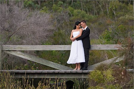 A couple in formal dress in the bush settings of the Kingfisher Bay Resort on Fraser Island. Stock Photo - Rights-Managed, Code: 862-03288755