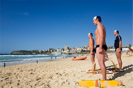 Members of the Bondi Surf Bathers Life Saving Club stand at the ready for a training rescue with traditional reel and line Stock Photo - Rights-Managed, Code: 862-03288861