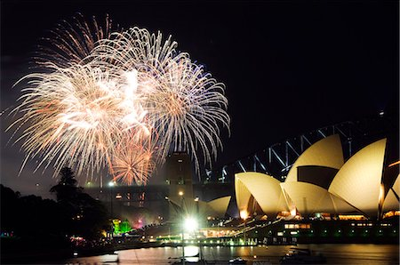 Australia,New South Wales,Sydney. Opera House and Coathanger Bridge with boats in Sydney Harbour - 2006 New Years Eve - 75th Diamond Anniversary Firework Celebrations. Stock Photo - Rights-Managed, Code: 862-03289094