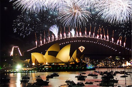 Australia,New South Wales,Sydney. Opera House and Coathanger Bridge with boats in Sydney Harbour - 2006 New Years Eve - 75th Diamond Anniversary Firework Celebrations. Stock Photo - Rights-Managed, Code: 862-03289092