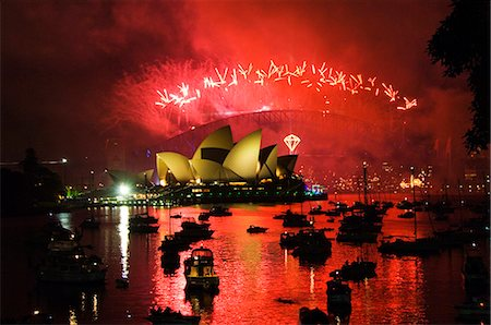 Australia,New South Wales,Sydney. Opera House and Coathanger Bridge with boats in Sydney Harbour - 2006 New Years Eve - 75th Diamond Anniversary Firework Celebrations. Stock Photo - Rights-Managed, Code: 862-03289093