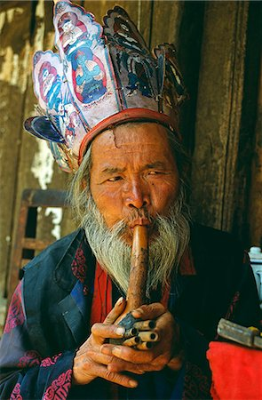 A Naxi Dongba,or wise man and essentially a shaman,traditionally acted as a mediator with the spirit world. The Dongba religion is itself an off-shoot of Tibet's pre-Buddhist Bon religion. Stock Photo - Rights-Managed, Code: 862-03289874