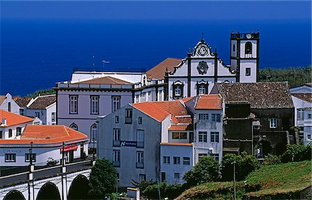Church tower dominates the town of Nordeste on the island of Sao Miguel,Azores Stock Photo - Rights-Managed, Code: 862-03354424