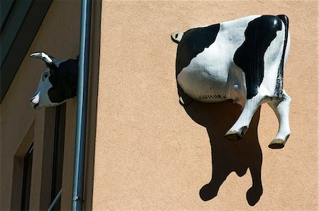 quirky - A Model Cow is made to look attached to a building,Interlaken,Jungfrau Region,Switzerland Stock Photo - Rights-Managed, Code: 862-03354666