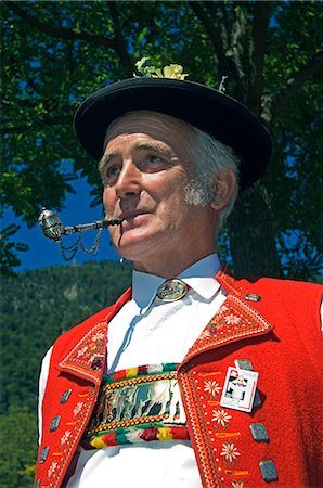 A Swiss man smoking a pipe in traditional alpine costume at the Unspunnen Bicentenary Festival,Interlaken,Jungfrau Region,Switzerland Stock Photo - Rights-Managed, Code: 862-03354681