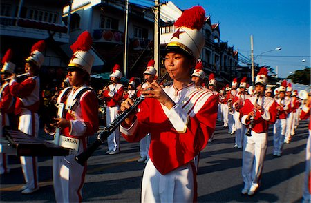 Marching Thai boys playing music in a band parade at Parasol Festival,Chang Mai Stock Photo - Rights-Managed, Code: 862-03354983
