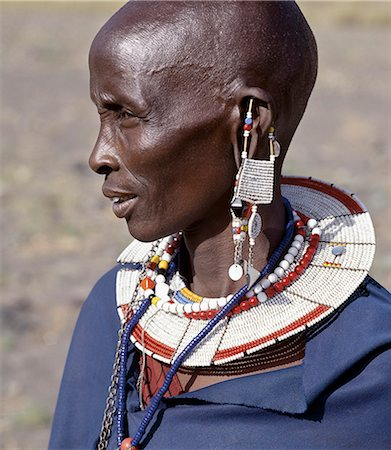 A Maasai woman in traditional attire. The preponderance of white glass beads in her ornaments denotes that she is from the Kisongo section of the Maasai,the largest clan group,which lives on both sides of the Kenya-Tanzania border. Stock Photo - Rights-Managed, Code: 862-03355138