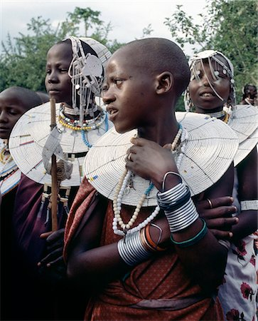 Maasai girls gather to celebrate a wedding. Their broad beaded necklaces with predominantly white glass beads mark then as Kisongo Maasai,the largest clan group of the tribe which lives either side of the Kenya-Tanzania border. Stock Photo - Rights-Managed, Code: 862-03355142