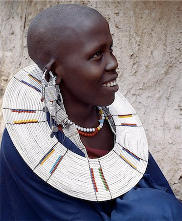 A Maasai woman wearing a very fine beaded necklace. The predominant white colour of her glass beadwork marks her as a Kisingo Maasai,the largest clan group of her tribe living either side of the Kenya-Tanzania border. Stock Photo - Rights-Managed, Code: 862-03355143