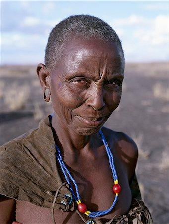 An old Datoga woman. Her traditional attire includes a beautifully tanned and decorated leather dress . The Datoga (known to their Maasai neighbours as the Mang'ati and to the Iraqw as Babaraig) live in northern Tanzania and are primarily pastoralists. Stock Photo - Rights-Managed, Code: 862-03355206