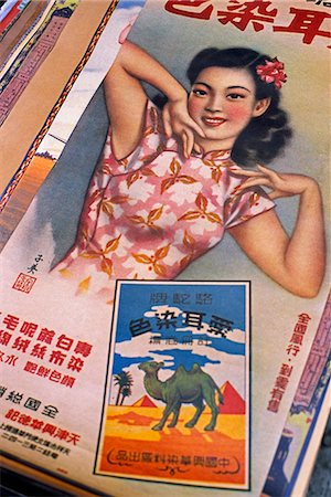 poster - A vintage poster for exotic travel sits amongst antiques and curios in the Cat Street Market in Sheung Wan district,Hong Kong Stock Photo - Rights-Managed, Code: 862-03350966
