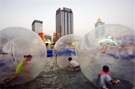 China,Shandong Province,Qingdao City. Amusement park at the Qingdao International Beer Festival. Qingdao is the host of the sailing events of the 2008 Olympic Games. Stock Photo - Rights-Managed, Code: 862-03351186