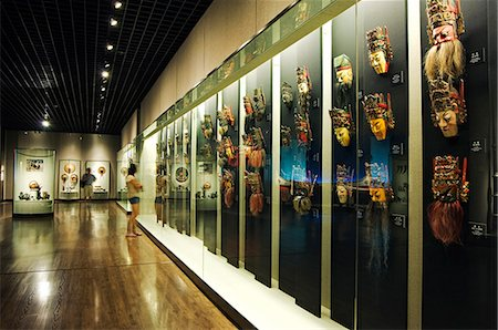 exhibition - China,Shanghai,Shanghai Museum. Chinese Minority Nationalities Art Gallery - colour lacquered wooden masks for Di Xi. Stock Photo - Rights-Managed, Code: 862-03351250
