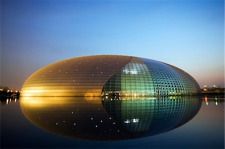 China Beijing An illuminated National Grand Theatre Opera House known as The Egg and designed by French architect Paul Andreu . Stock Photo - Rights-Managed, Code: 862-03351427
