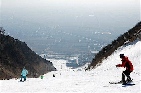 panoramic winter scene - China,Beijing,Shijinglong ski resort. Skiers on the mountain. Stock Photo - Rights-Managed, Code: 862-03351465