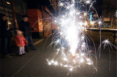 China,Beijing. Chinese New Year Spring Festival - fireworks being let off in the street. Stock Photo - Rights-Managed, Code: 862-03351532