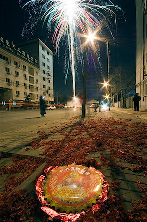 China,Beijing. Chinese New Year Spring Festival - fireworks being let off in the street. Stock Photo - Rights-Managed, Code: 862-03351533
