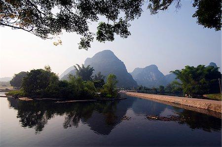 China,Guangxi Province,Yangshuo near Guilin. Karst limestone mountain scenery on the Li River Stock Photo - Rights-Managed, Code: 862-03351779
