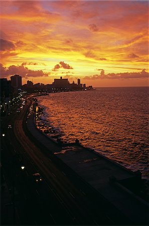 road landscape - Sunset over the Malacon Havana's seafront with sea front hotels and street lights,Havana,Cuba Stock Photo - Rights-Managed, Code: 862-03352471