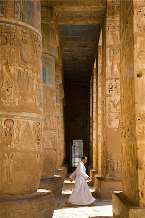 egyptian hieroglyphics - The colours of the original painting dating from the New Kingdom can still be seen on the columns of Ramses III's mortuary temple at Medinet Habu on the West Bank,Luxor,Egypt Stock Photo - Rights-Managed, Code: 862-03352909
