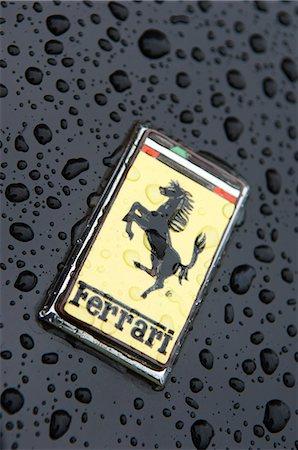 Logo on bonnet of Ferrari sportscar Stock Photo - Rights-Managed, Code: 862-03353731