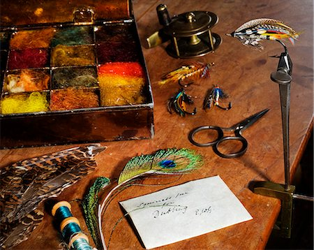 UK. Antique fly-tying equipment with a traditionally tied salmon fly in the vice on a fly-tiers bench Stock Photo - Rights-Managed, Code: 862-03353766