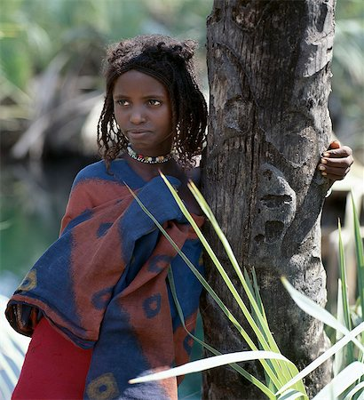 A young Afar girl at Filwoha in the Awash National Park. Filwoha in the Afar language means 'hot water'. The beautiful springs are surrounded by doum palms and rise from deep underground at about 96.8 degrees F. Stock Photo - Rights-Managed, Code: 862-03353976