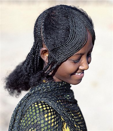The fetching hairstyle of a young Afar girl. Proud and fiercely independent,the nomadic Afar people live in the low-lying deserts of Eastern Ethiopia. Stock Photo - Rights-Managed, Code: 862-03353970