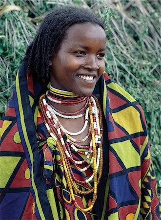 A pretty Borana girl at Mega in southern Ethiopia wears brightly coloured cotton cloth and numerous strings of beads. The pastoral Borana live either side of the southern Ethiopian/northern Kenya border and form a large and important group of the Oromo-speaking cluster of tribes. Stock Photo - Rights-Managed, Code: 862-03353991