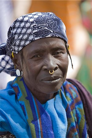 Mali,Djenne. A Peul woman wearing a gold nose ornament at Djenne market. The weekly Monday market is thronged by thousands of people and is one of the most colourful in West Africa. Stock Photo - Rights-Managed, Code: 862-03364144
