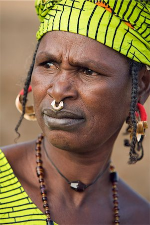 Mali,Douentza. A Bella woman wearing gold jewellery in her village near Douentza. The Bella are predominantly pastoral people and were once the slaves of the Tuareg of Northern Mali. Stock Photo - Rights-Managed, Code: 862-03364162