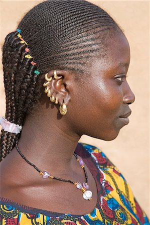 Mali,Douentza. A Bella woman with braided hair wearing gold ear rings in her village near Douentza. The Bella are predominantly pastoral people and were once the slaves of the Tuareg of Northern Mali. Stock Photo - Rights-Managed, Code: 862-03364163